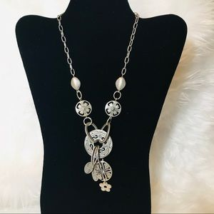Silver Y necklace with charm detail.